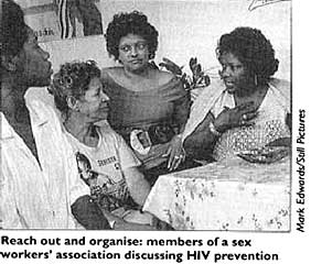 Reach out and organise: members of a sex workers' association discussing HIV prevention