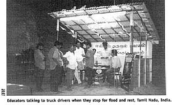 Educators talking to truck drivers when they stop for food and rest, Tamil Nadu, India.